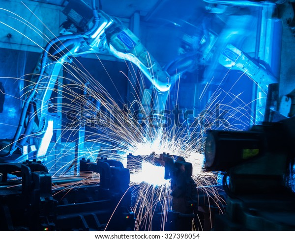 Team welding robots represent the movement. In the automotive parts industry.