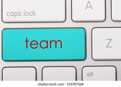 Team word written on computer keyboard.