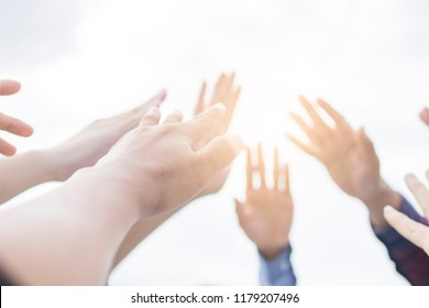 Team work concept, group of hand raise and show on sky