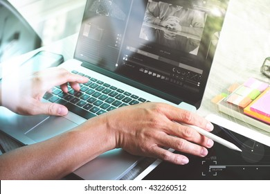 Team work concept,businessman hand attending video conference in modern office.Digital tablet laptop computer design smart phone using. Sun effects, Blurred background