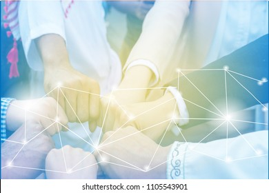 Team work concept.Businessman hands shaking together. Working as a business team is a network of links. Which helps each other and grow the business and respect each other and help the mission succeed