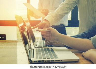 Team work concept,team meeting,man and woman working in the office. collaborative teamwork. Project managers meeting.business crew working with new startup.Analyze plans.selective focus,vintage color