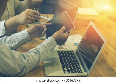 Team work concept,team meeting,man and woman working in the office. collaborative teamwork. Project managers meeting.business crew working with new startup. Analyze plans.selective focus,vintage color
