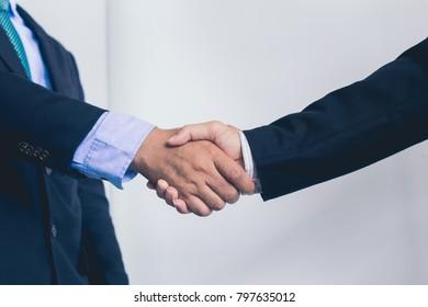 Team work handshake after meeting completion
