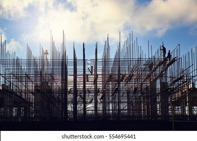 Team of  workers building pile with blue sky on the backgrounds. New skyscraper.