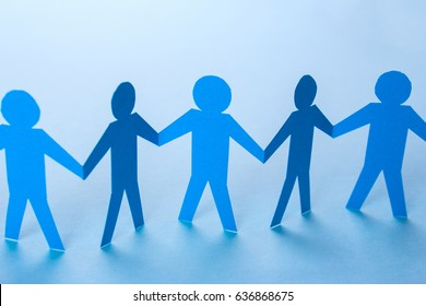 A team of workers hold hands, partnerships. Help people missionary. Support group to success. The rule of six handshakes. Group of people talking in social network. Paper buns holding hands