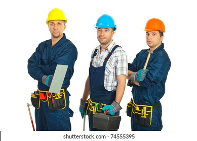 Team of constructor workers in a line holding tools isolated on white background