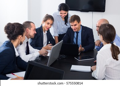 Team working meeting and discussion on business project in office