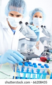 Team working with microscopes in a laboratory