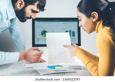 team workingin document with computer in office
