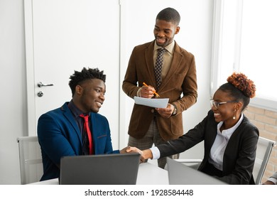 team of young african people in the office at the table with a laptop