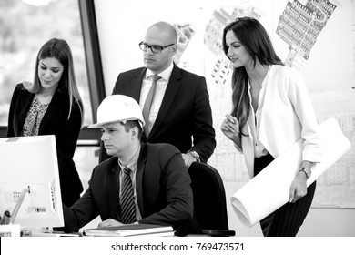 Team of young architects discussing latest plans