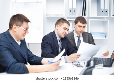 Team of young business men working together at office