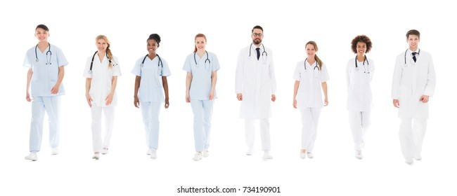 Team Of Young Doctors With Stethoscopes Over White Background