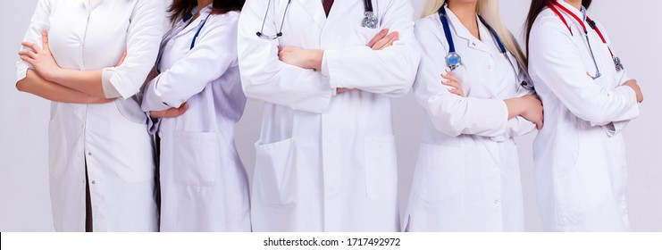 A team of young doctors in white robes. A group of medical students of different nationalities are looking in the cell. Covid-19 pandemic