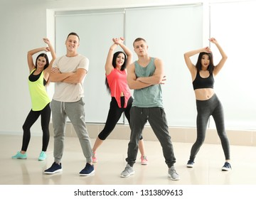 Team of young people dancing in studio