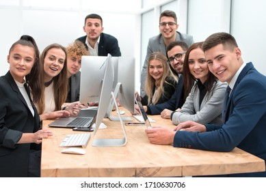 team of young professionals sitting at an office Desk