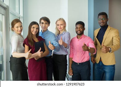 team of young professionals at work in the office with a hand gesture