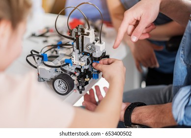 Team of young technicians working together
