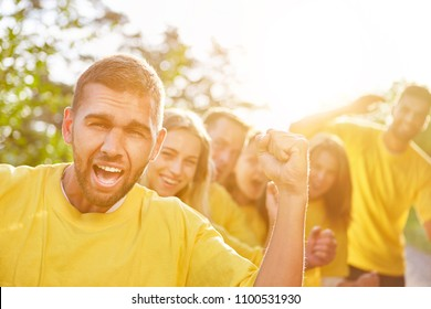 Teambuilding with cheering team or group in nature