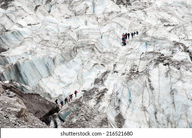 Teams of walkers crossing Fox Glacier, New Zealand