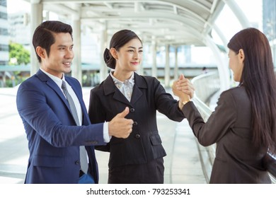 Teamwork of Asian business peoples