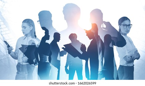 Teamwork and business meeting concept. Silhouettes of diverse business people with double exposure of abstract cityscape. Toned image