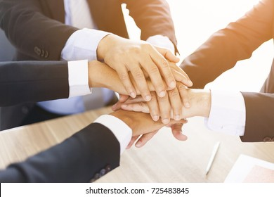 Teamwork - Business partners,friendship and togetherness Collaboration Concept. group of colleagues join hands together.