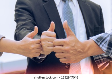 Teamwork of business people raised thumb up,  expression you can do it, great job, keep fighting.