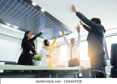 Teamwork business people throw papers and documents fly in the air while excited happy smile. Success team concept after sign contract or finished their work.