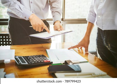 Teamwork businessman officer working hard investing financial reports and calculating colleagues for successful project.
