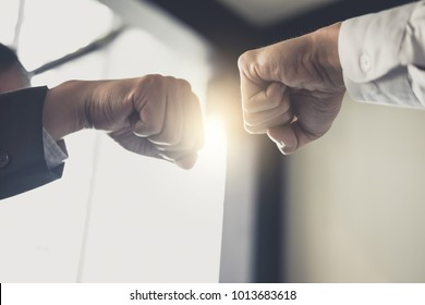 Teamwork of businessman partnership giving fist bump to greeting start up business strategy project.