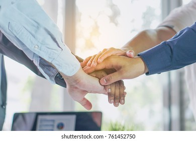 Teamwork of businessmen in company. Close up hands of group businessmen stacking show power collaborate.