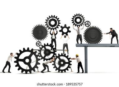 Teamwork of businesspeople at work to build a business system
