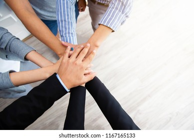 Teamwork concept. Business peoples putting their hands together in top view. Stack of hands for unity and team. Success business.