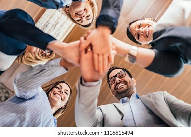 Teamwork concept. Business team joining hands together.