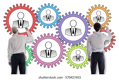 Teamwork concept drawn on a white wall by businessmen