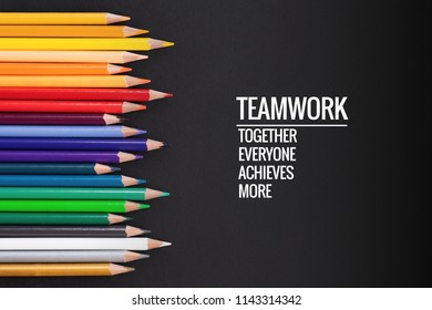 Teamwork concept. group of color pencil on black background with word Teamwork, Together, Everyone, Achieves and More