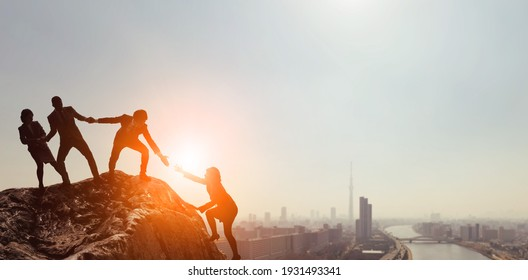 Teamwork concept. People who help their peers. Human relationship.