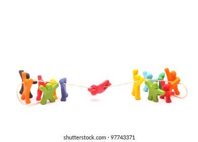 teamwork concept with plasticine puppets. educational cooperation training building trust and responsibility - isolated on white