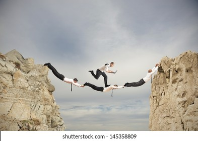 Teamwork concept with running businessman with laptop