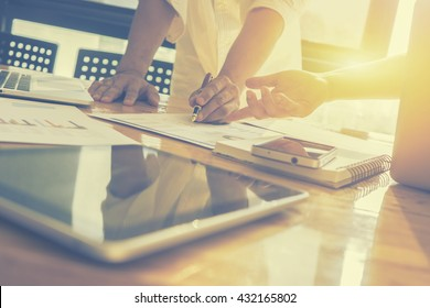 Teamwork  concept,man and woman operate in the office with collaborative cooperation or participation,Project managers meet a business crew working with new startup. Analyze business plans