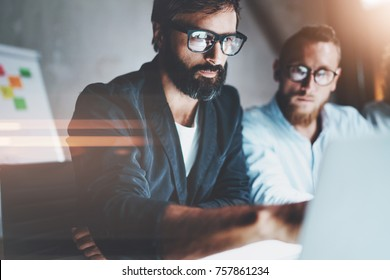 Teamwork concept.Project team managers making conversation at meeting room at office.Horizontal.Blurred background.Flares