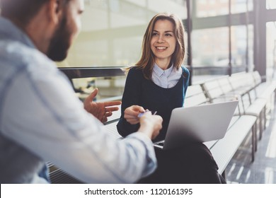 Teamwork concept.Young creative coworkers working with new startup project in modern business center.Group of two entrepreneur making discussion.Blurred background