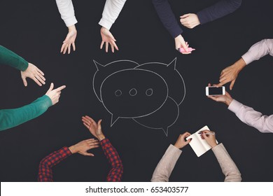 Teamwork and cooperation concept - top view of six people work on a blackboard.