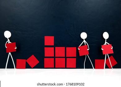 Teamwork, cooperation and rebuilding business concept. Human stick figures fixing broken building blocks.