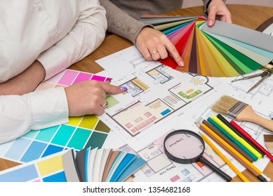 Teamwork of creative designers working with colour palette