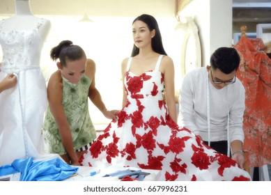 Teamwork designer concept : Fashion designer working near mannequin in office
