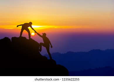 https://image.shutterstock.com/image-photo/teamwork-friendship-hiking-help-each-260nw-1155622255.jpg