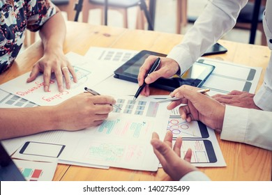 Teamwork graphic designers creative drawing website ux-ui app development and application for mobile office.